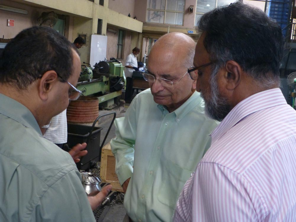 Dr. Sehra on a tour of the manufacturing facilities at Corrtech Energy
